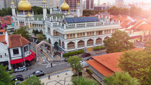 Masjid Sultan, Singapore Mosque In Historic Kampong Glam. Panoramic Aerial View With City Buildings