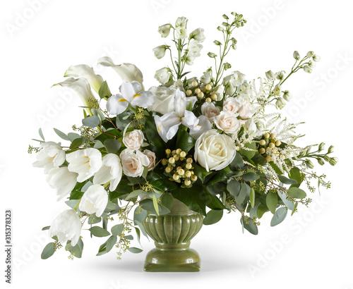 Arrangement of white flowers in green vase