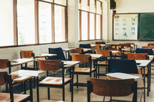 Selective Soft And Blur Focus.old Wooden Row Lecture Chairs In Dirty Classroom In Poor School.study Room Without Student.concept For Education In Third World ,donate And Charity,background Text.