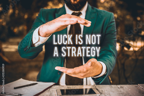 Fotografía Conceptual hand writing showing Luck Is Not A Strategy