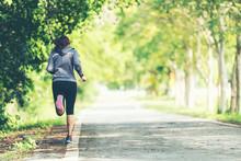 Sporty Asian Woman Runner Runn...