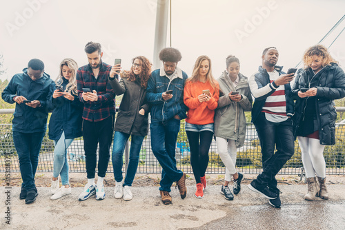 Photo Group of young people staring on their phones