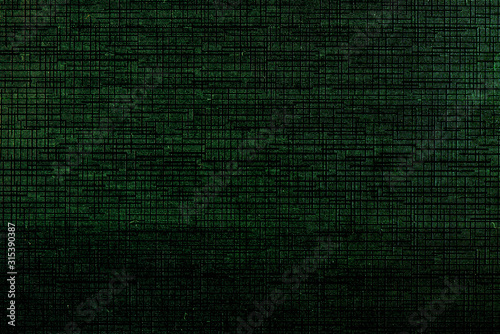 Photo Abstract black digital technology background with green luminous particles dots