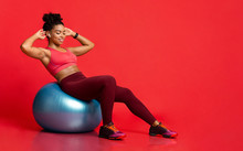 Young Sporty Black Girl Working Out With Fitness Ball
