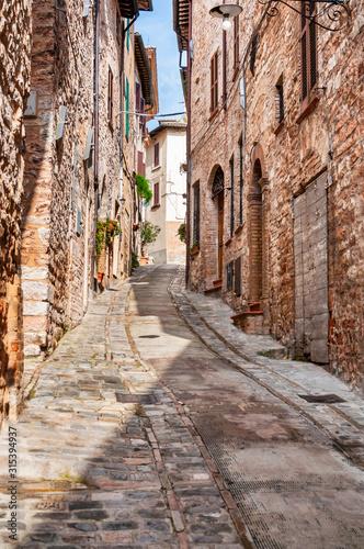 Fototapeta Narrow street in the smal viallge of Spello, Italy