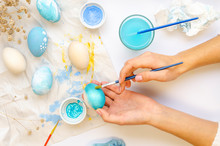 Easter Eggs Painting Process. ...