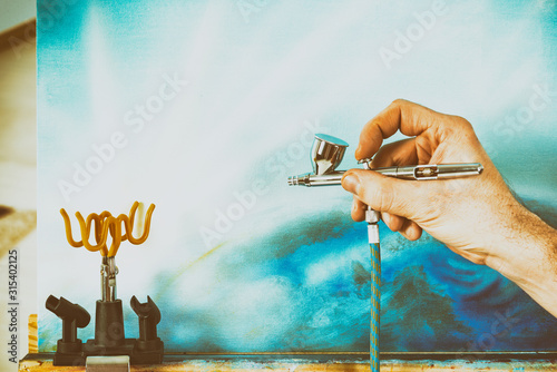 Airbrush on stand Wallpaper Mural