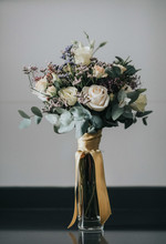 Glass Vase With Bunch Of White...