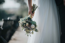 Crop Bride With Bouquet In Forest
