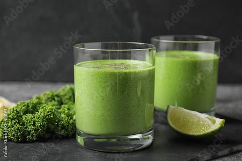 Fototapeta Tasty kale smoothie with chia seeds on black table, closeup obraz