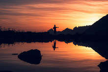 Silhouette Of Person Balancing...