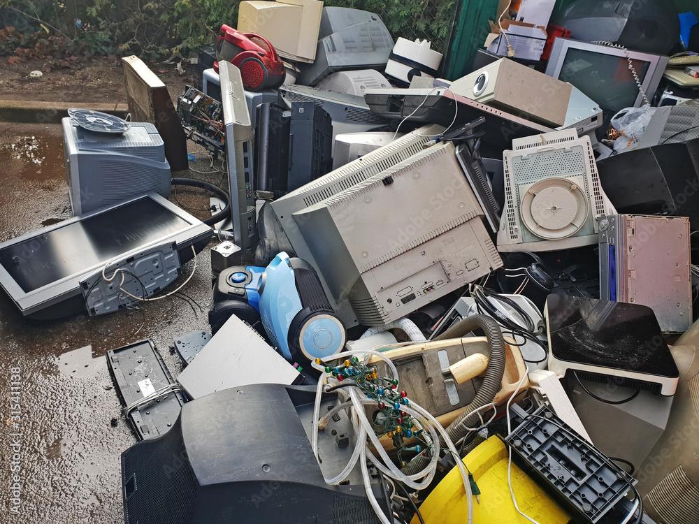 Fototapeta Pile of used electronic and housewares waste