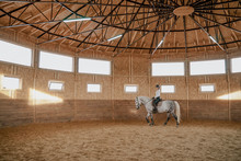 Rider Riding Dapple Gray Horse In Round Arena