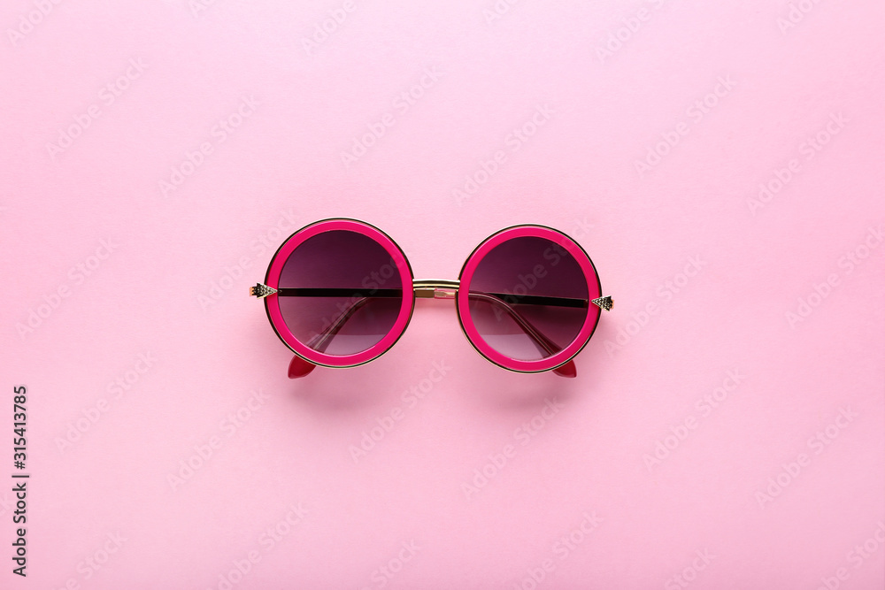 Fototapeta Modern sunglasses on pink background