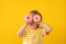 Happy Child Holding Glazed Donut