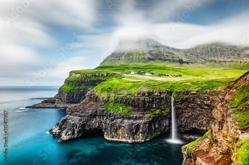 Fototapeta Incredible day view of Mulafossur waterfall in Gasadalur village, Vagar Island of the Faroe Islands, Denmark. Landscape photography obraz
