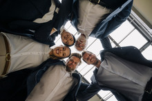 Happy Business People Huddling In Office