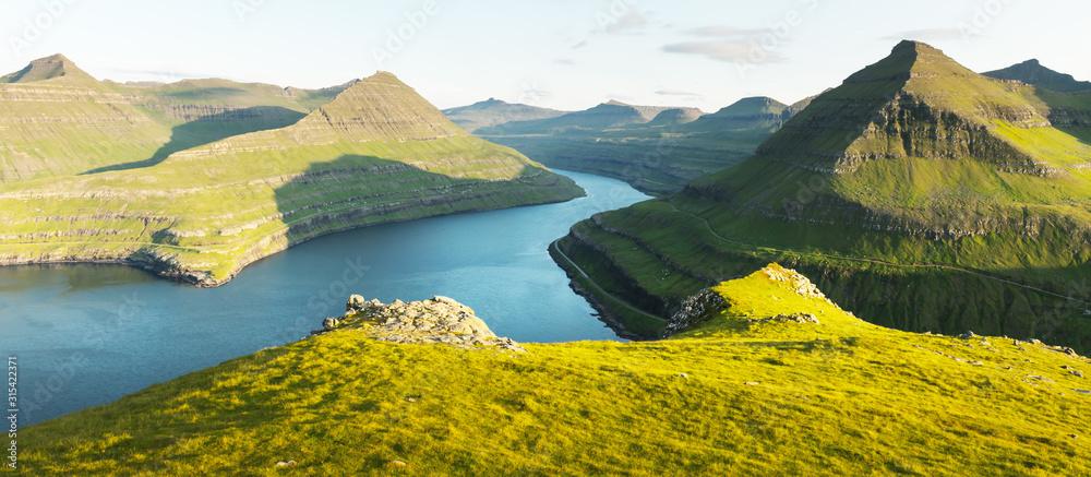 Fototapeta Panorama over majestic sunny fjords of Funningur, Eysturoy island, Faroe Islands. Landscape photography