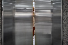 Doors Closing Of An Elevator With A Young Woman Inside