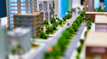 Modern Generic Contemporary Style Miniature Model Of Glass Buildings And Streets With Tilt-shift Focus Technique - Focus Is On The Red Car In The Middle Of The Street