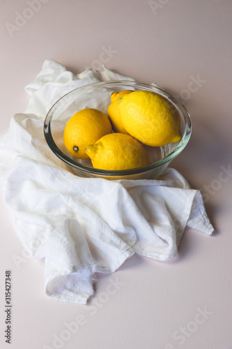 Lemons in a glass bowl, light and aerie still life Canvas Print