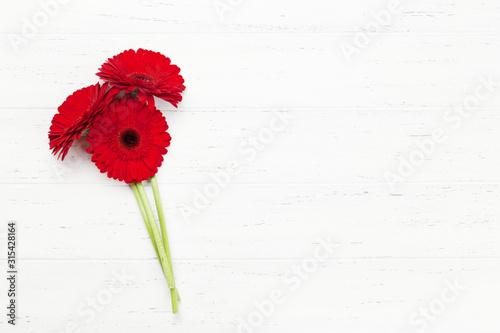 Obraz na plátně Valentines day greeting card with gerbera flowers