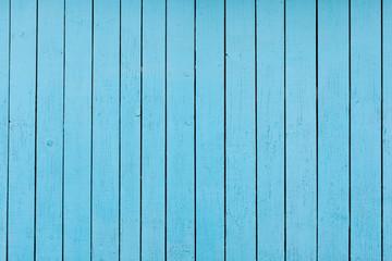 Textura de pranchas de madeira pintadas com tinta azul.