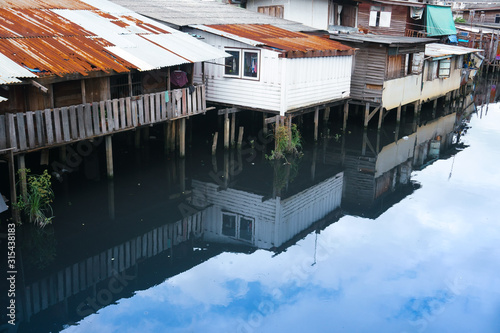 Small houses, slum near canal Fototapet