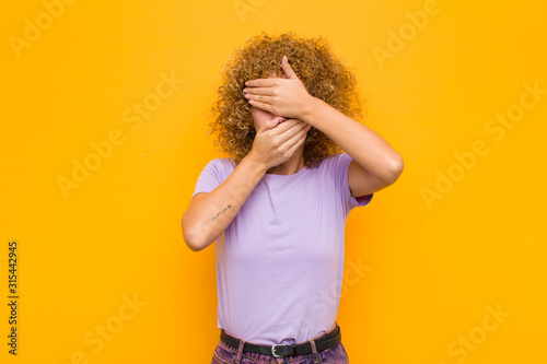 young afro woman covering face with both hands saying no to the camera! refusing Tablou Canvas