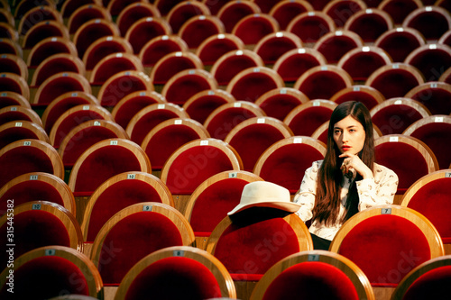portrait of a pretty girl hipster in a movie theater posing in fashion style, dr Wallpaper Mural
