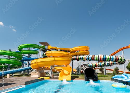 Fototapeta Outdoor water park. Multi-colored slides and pools. obraz na płótnie