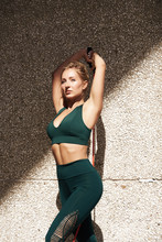 Fitness Woman Using Kettlebells Outside During Fitness Strength Training Against Copyspace
