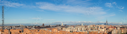 Skyline of the city of Madrid, on a day with blue sky and clouds, from the popular neighborhood of Vallecas