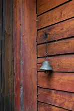 A Metal Bell On An Old Wooden ...