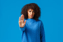 Time To Stop. Sinecere And Upset, Gloomy Young Caring African American Female Friend Trying Prevent Bad Things, Pulling Hand In Forbid, Prohibition Or Disagree Gesture, Warning Over Blue Background