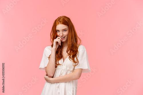 Fotografia Sensual, romantic and sassy, seductive redhead daring woman in white dress, biti
