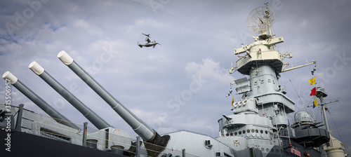 Helicopter Over a Battleship Wallpaper Mural