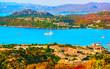Landscape and scenery of Golfo Aranci at Costa Smeralda, Sardegna island in Italy in summer. Sassari province near Olbia and Cagliari. In Mediteranean sea. Yachts, boats and ships. Mixed media.