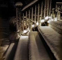 Fresh Snowfall On The Backyard Deck At Night