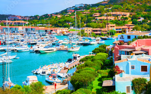 Fotografía Scenery with Marina and luxury yachts at Mediterranean Sea of Porto Cervo in Sardinia Island of Italy in summer