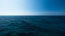 Dark And Blue Open Sea With Blue Sky