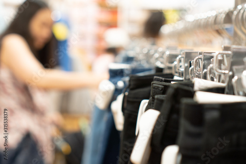 Photo Close up clothes hangers on rack with anti theft alarm