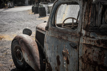 Abandoned Rusty Car Stands Alo...