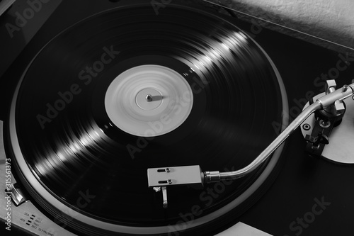 Fotomural Vintage record player with vinyl record for background
