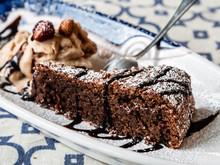 Slice Of Tasty Chocolate Caprese Dessert With Hazelnut Mousse With Strawberry