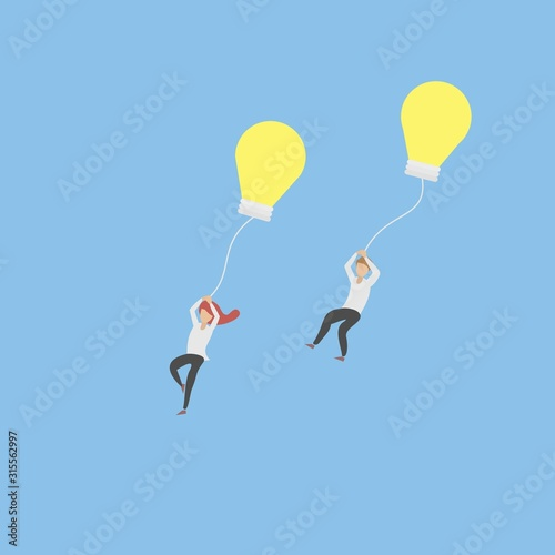 Photo Release creative idea concept,Man and women let idea go to the sky with yellow light bulb