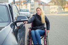 Handicapped Woman In A Wheelch...