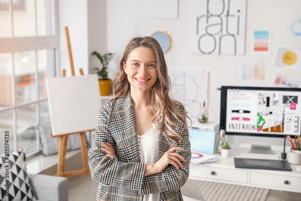 Fototapeta Portrait of female interior designer in office