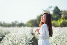 Portrait Image Of An Asian Woman In A Beautiful Cutter Flower Field