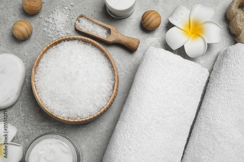 Obraz Flat lay composition with cosmetics and sea salt on grey marble table. Spa treatment - fototapety do salonu